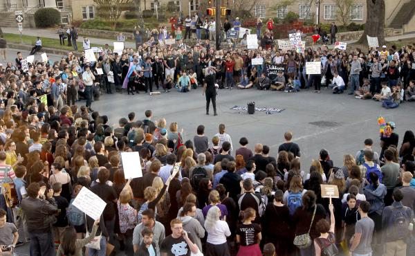 Hundreds attend a rally in Chapel Hill, N.C., on March 29 to protest the passage of House Bill 2. The state of North Carolina and the U.S. Justice Department are suing each other over the law's restriction on protections for lesbian, gay, bisexual and tra
