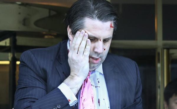 U.S. Ambassador to South Korea Mark Lippert leaves Sejong Center for the Performing Arts in downtown Seoul, South Korea, after the attack.