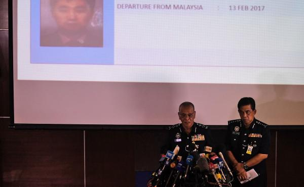 Noor Rashid Ibrahim (left) of the Royal Malaysian Police speaks about one of the North Korean suspects, with Selangor state police chief Abdul Samah Mat looking on, in Kuala Lumpur on Sunday.