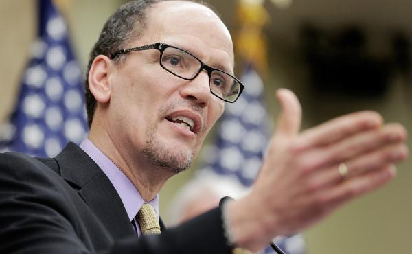 """Secretary of Labor Thomas Perez speaks at the U.S. Capitol during a stop on the """"Give America a Raise"""" bus tour, April 3, 2014."""