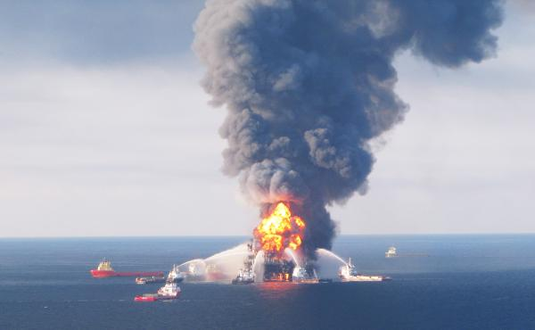 """Boats battle a fire at the offshore oil rig Deepwater Horizon on April 21, 2010. On Thursday, the Interior Department released what it called """"the most significant safety and environmental protection reforms the Interior Department has undertaken since De"""