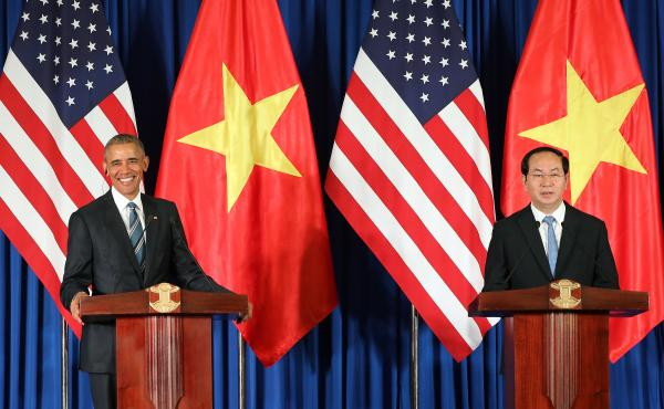 Vietnamese President Tran Dai Quang and U.S. President Obama take part in a joint press conference Monday at the International Convention Center in Hanoi.