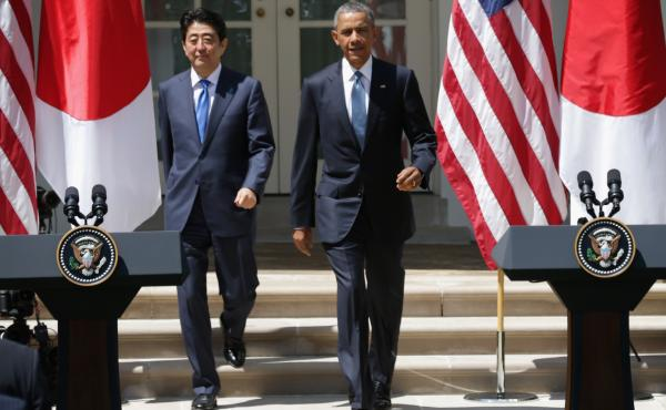 President Obama and Japanese Prime Minister Shinzo Abe approach the podiums for a joint press conference Tuesday at the Rose Garden of the White House in Washington. President Obama is hoping to finalize a new trade agreement with Japan and other Asian na
