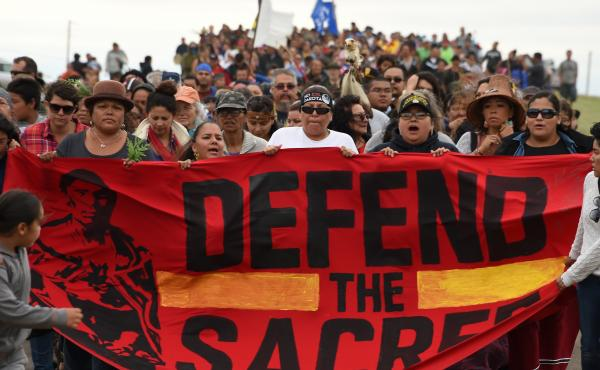 Native Americans and other activists march to a sacred burial ground site that was disturbed by construction of the Dakota Access Pipeline. Hundreds of people have joined the Standing Rock Sioux Tribe's protest of the oil pipeline.