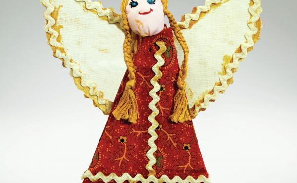 This handmade angel was given to Bonnie Mackay by a former colleague in the Bloomingdale's Home Furnishings and Fashion office. It is one of the nearly 3,000 ornaments in her collection, which she has categorized into 67 different classifications.