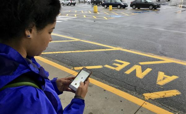 Dania Matos, 22, a student at North Short Community College in Danvers, Mass., waits for an Uber car to take her to school.