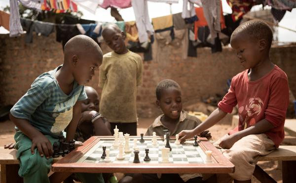 Children make their moves at the Katwe Chess Academy, located in a slum in Kampala, Uganda. The Academy is where Phiona Mutesi, whose story is the basis for the movie Queen of Katwe, learned to play.