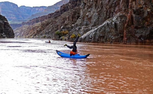 Nabors and Kemp rafted the Colorado River to check the Grand Canyon — park #22 — off their list. Here, Darius Nabors tries out a mid-river headstand.