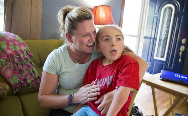 Brenda Hummel and her 7-year-old daughter Andrea in their home near Des Moines, Iowa. Andrea was born with severe epilepsy and gets her health care through Medicaid.