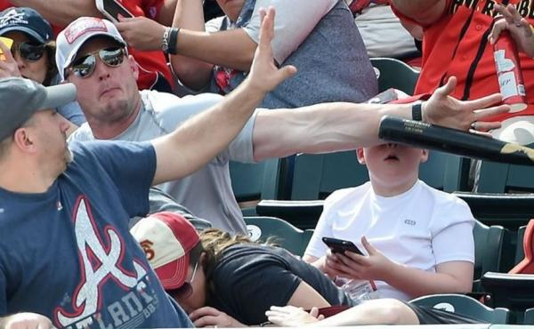 A man's fast reaction helped keep a young fan from being struck in the face by a baseball bat at a spring training game this weekend.