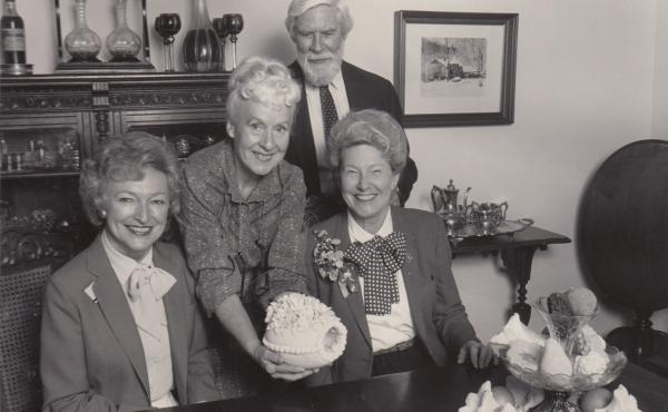 "Phila Hach (standing, center) and her husband, Adolf Hach, are seen here with Minnie Pearl (right) of Grand Ole Opry fame, and an unidentified woman. ""What the Grand Ole Opry did for country music, she has done for Southern food,"" one food writer wrote ab"