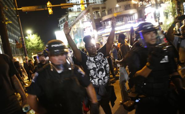 Protestors march Wednesday to protest the Tuesday shooting death of Keith Lamont Scott in Charlotte, N.C. Scott, who was black, was shot and killed by police officers, who say they warned Scott to drop a gun he was allegedly holding. Relatives and neighbo