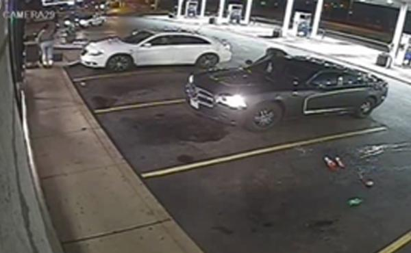 Surveillance video shows a scene leading up to a police officer shooting and killing an armed man at a gas station in Berkeley, Mo. The St. Louis County Police Department is investigating the case, in which an 18-year-old man died.