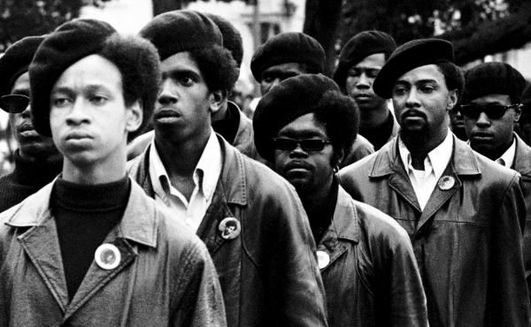 Members of the Black Panthers line up at a rally at DeFremery Park in Oakland, Calif.