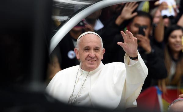 Pope Francis waves during a parade to an open-air Mass in Philadelphia on Sunday.
