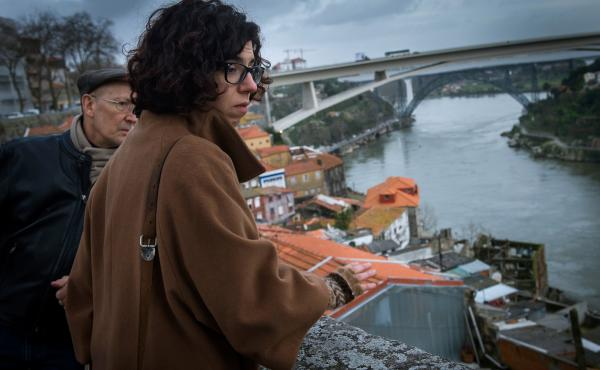 Portuguese architect Margarida Castro (right) provides a tour of  Porto in 2014. She is one of three unemployed architects who set up Worst Tours to show visitors the poverty in the city, which has been hard hit by the country's weak economy in recent yea