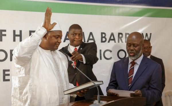 Adama Barrow was sworn in as President of Gambia at Gambia's embassy in Dakar, Senegal on Thursday in the nation's first peaceful and democratic transfer of power.