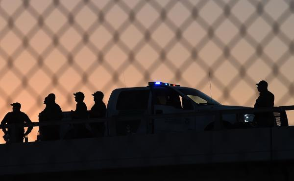U.S. Border Patrol officers keep watch at the fence separating U.S. and Mexico in the town of El Paso, Texas.
