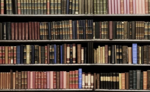 Desaturated colors. Old books in a library.