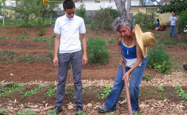 """Dalma Cartagena teaches a class on agricultural science to elementary-school students in Orocovis, Puerto Rico. """"I'm preparing them to make good decisions when it comes to the environment and healthy foods,"""" she says."""