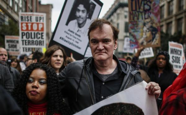 """Director Quentin Tarantino attends a march to denounce police brutality in New York City on Oct. 24. At the rally, Tarantino said, """"I have to call the murdered the murdered, and I have to call the murderers the murderers"""" — drawing considerable backlash"""