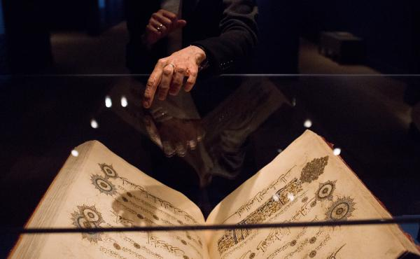 """Massumeh Farhad points to one of the Qurans in the exhibition. As curator, she flipped through all of the books on display. """"Every page is absolutely breathtaking,"""" she says."""