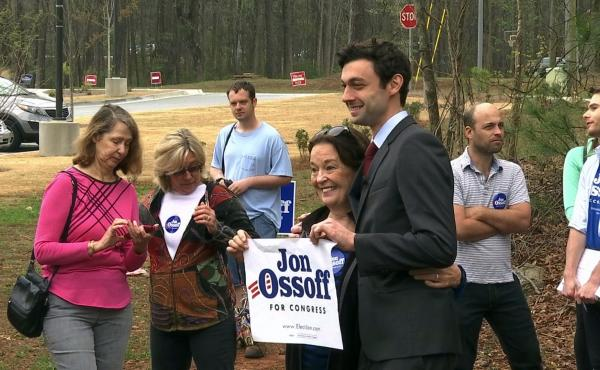 Democratic congressional candidate Jon Ossoff poses with supporters outside the East Roswell Branch Library in Roswell, Ga.