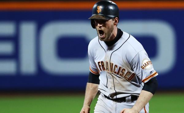 San Francisco's Conor Gillaspie celebrates his three-run home run in the ninth inning, propelling the Giants to a 3-0 win over the New York Mets in the National League wild-card game.