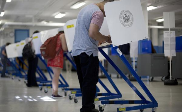 Voters cast their ballots during the presidential primary in New York City on April 19. Twenty-three states require employers to offer some form of paid leave to vote.