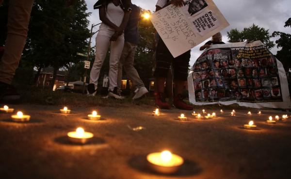 Friends of Paul O'Neal attend a vigil to remember him on Aug. 5, 2016, in Chicago. O'Neal, an unarmed 18-year-old man, was shot and fatally wounded the month before when Chicago police officers tried to arrest him for allegedly stealing a car from the sub