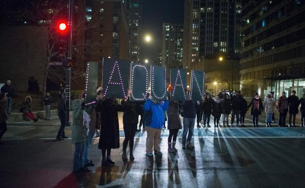 Demonstrators march through downtown Chicago on Tuesday following the release of a video showing Jason Van Dyke, a police officer, shooting and killing Laquan McDonald. Van Dyke is charged with first-degree murder for the October 2014 shooting in which Mc