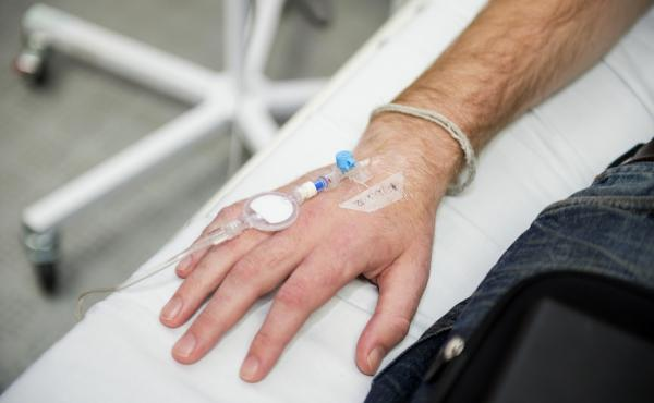 A patient with Crohn's disease receives an IV infusion of Remicade, or infliximab.