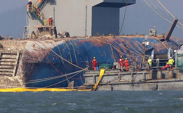 Workers attempt to salvage the sunken Sewol ferry in waters off the island of Jindo, South Korea. The Sewol sank in April 2014, killing more than 300 people.
