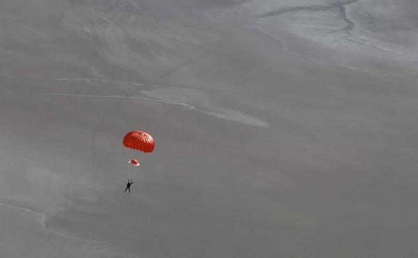 A photo released by Virgin Galactic shows a badly injured SpaceShipTwo pilot Peter Siebold drifting under his parachute after last October's accident that destroyed the spacecraft during a test flight.