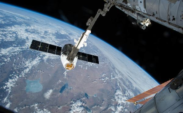 This is what failed to happen on Wednesday morning. In this image from April 17, 2015, a robotic arm on the International Space Station grasps a SpaceX Dragon cargo ship during docking.