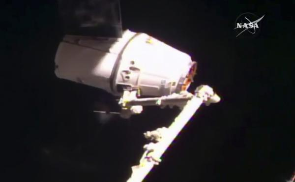 SpaceX's Dragon cargo ship is captured by astronauts aboard the International Space Station early Thursday, one day after its initial docking attempt was aborted.