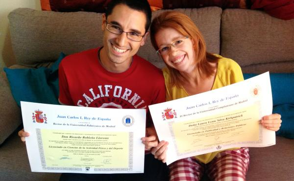 Ricardo Robleño Llorente and his wife, Laura Silva Kirkpatrick, show their college degrees at home in Madrid. Even though they have two bachelor's degrees and a master's between them, they were unable to find permanent work through most of their 20s, dur