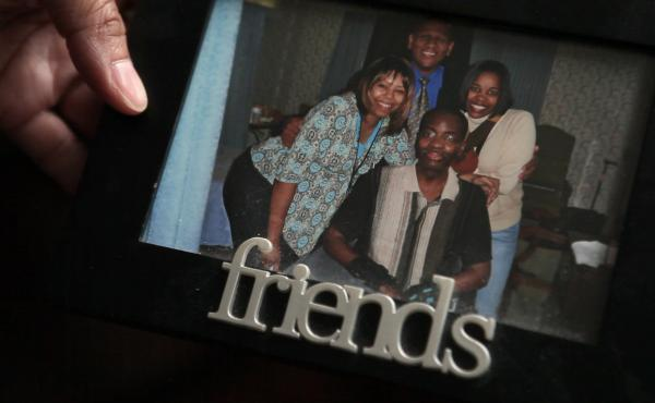 Kelli Glenn holds a photo of her father while he was in the hospital.