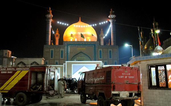 Pakistani soldiers cordon off the shrine of 13th-century Sufi saint Lal Shahbaz Qalandar, in the town of Sehwan, after a bomb killed dozens of worshippers Thursday.