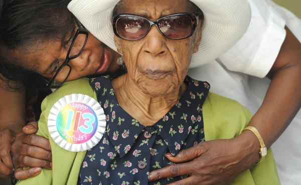 Miss Susie Susannah Mushatt Jones with her niece Lois Judge as they celebrate her 113th birthday with a party at the Vendalia Senior Center in Brooklyn in 2012.
