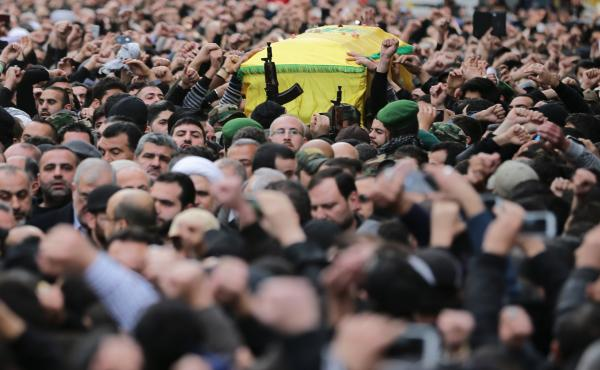 Lebanese Hezbollah supporters carry the coffin of Jihad Mughniyeh during his funeral in Beirut on Monday. Mughniyeh was one of six ranking members of Hezbollah killed in a suspected Israeli strike Sunday. Iran says a general of its elite Revolutionary Gua