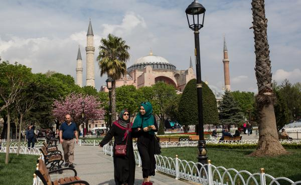 People walk in front of Istanbul's Hagia Sophia on April 12. Turkey has seen tourist numbers plummet following a series of deadly terrorist attacks and a travel ban by Russia.