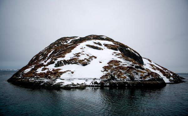 A small island sits in the middle of Kangeq's old harbor.