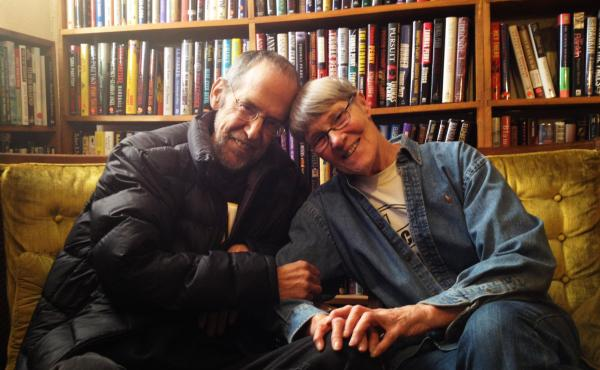"Gary Shulze, 66, and Pat Frovarp, 75, sit in Once Upon A Crime, the Minneapolis bookstore they ran for 14 years. On when they first met: ""Well, Gary was pretty doggone cute,"" says Frovarp. ""There's no doubt about it."""
