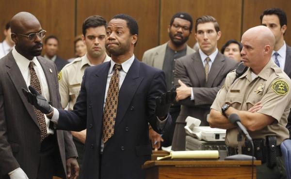 Sterling K. Brown as Christopher Darden and Cuba Gooding, Jr. as O.J. Simpson.