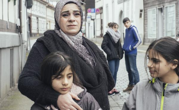 Watani: My Homeland follows Hala Kamil and her family as they move from Aleppo, Syria, to a small German city that welcomes refugees.