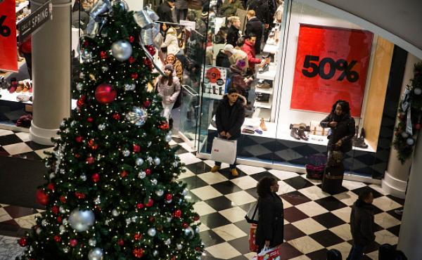 People do their holiday shopping in Manhattan Mall in New York City in November 2014. Retailers may have a harder time filling holiday jobs this year because of a shrinking pool of workers.