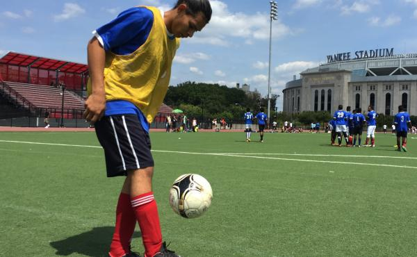 Carlos Alfaro, 19, practices with a soccer ball before a match in New York City. Some members of his youth soccer team are set to meet with Pope Francis in September.