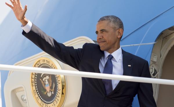 U.S. President Barack Obama waves from Air Force One prior to departing for a nine-day trip that will end in Laos, a relatively poor Southeast Asian nation run by communist government.