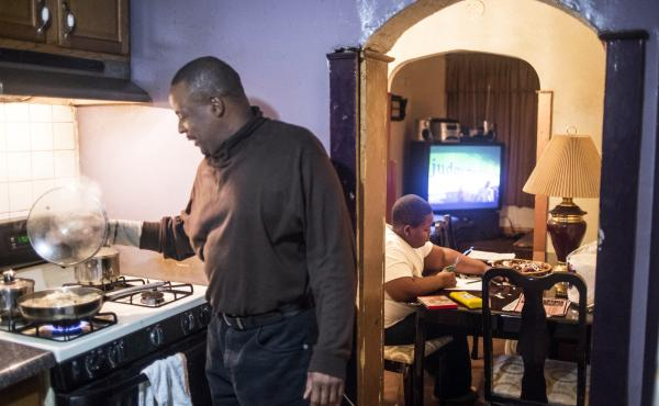 """Silvester Fullard fixes dinner for his 11-year-old son Tavestsiar. When Tavestsiar first came to live with his dad in 2010, he was closed off, Silvester says; """"he didn't want to be around other kids."""""""